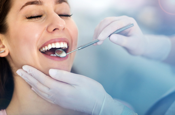 A Woman receiving Dental Services in Peoria, Arizona